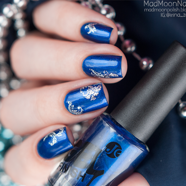Blue shimmer nails with silver water decals.  nail art by Irina Zorg