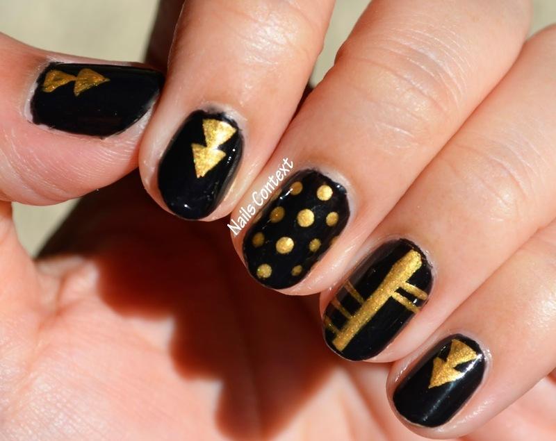 Trendy Black and Gold nail art by NailsContext
