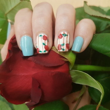 Roses are red, the rest of my nails are blue nail art by Lxnne