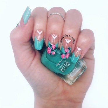 Pink roses with a hint of blue nail art by Camilla Nielsen