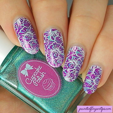 Flowers over a water marble nail art by Kerry_Fingertips