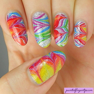 Rainbow water marble over silver nail art by Kerry_Fingertips