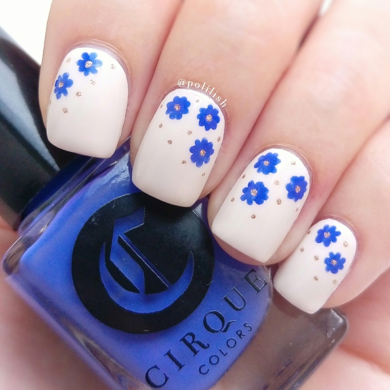 Freehand blue flowers nail art by polilish