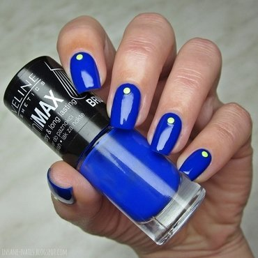 Electric blue nails with neon studs nail art by Sanela