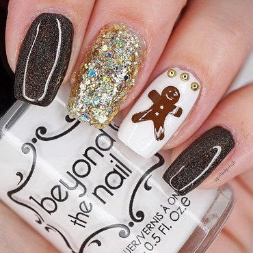 Gingerbread Man Nails nail art by Maddy S