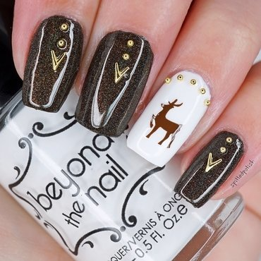 Brown and Gold Reindeer Nails nail art by Maddy S
