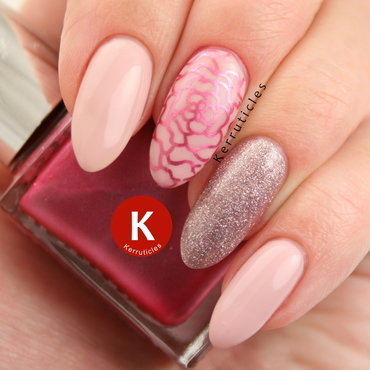 Pale pink gel nails with glitter and stamping nail art by Claire Kerr