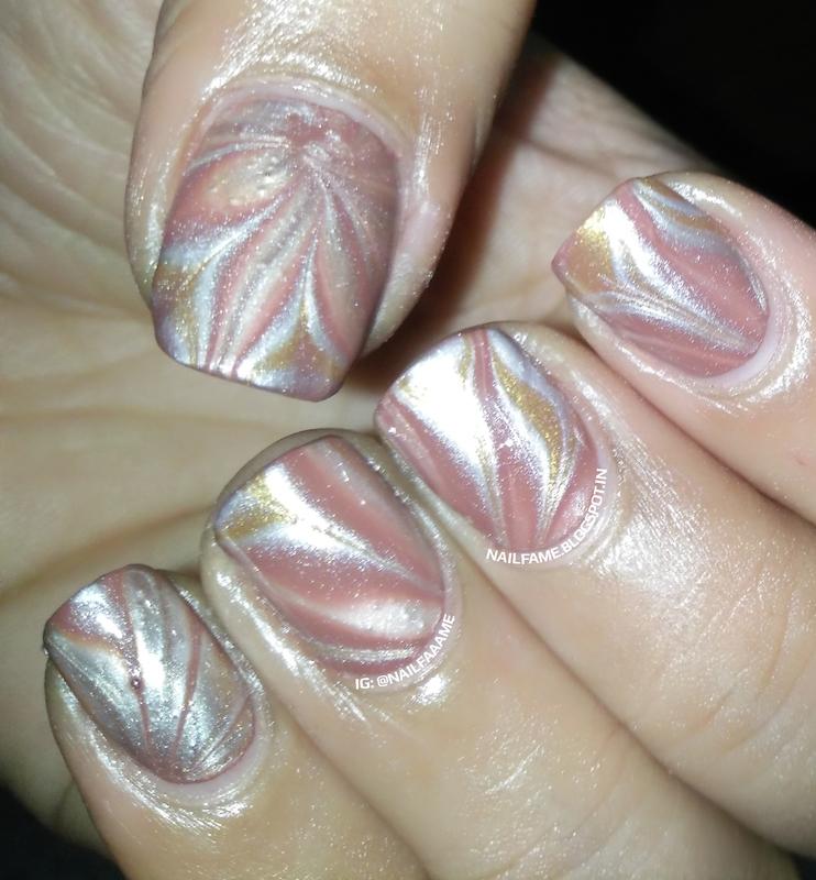 Watermarble Nails nail art by Nailfame