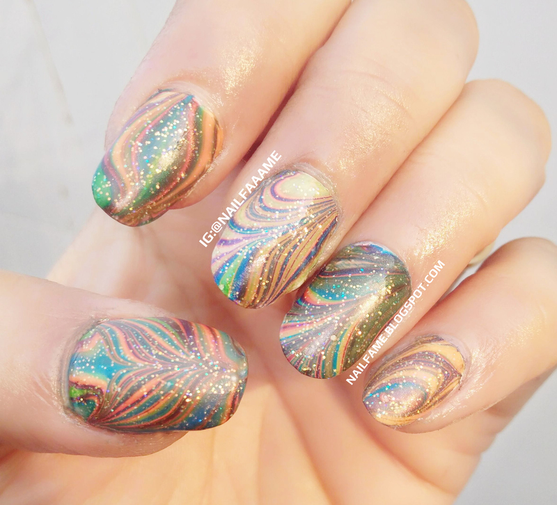 Colorful WaterMarble nail art by Nailfame