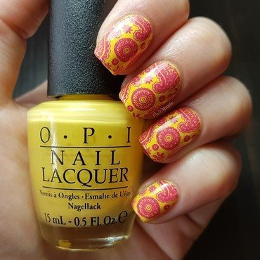 Pink paisleys and flowers on yellow nail art by Emmelie Slotboom