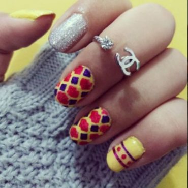 Yellow  nail art by Samia Tehreem