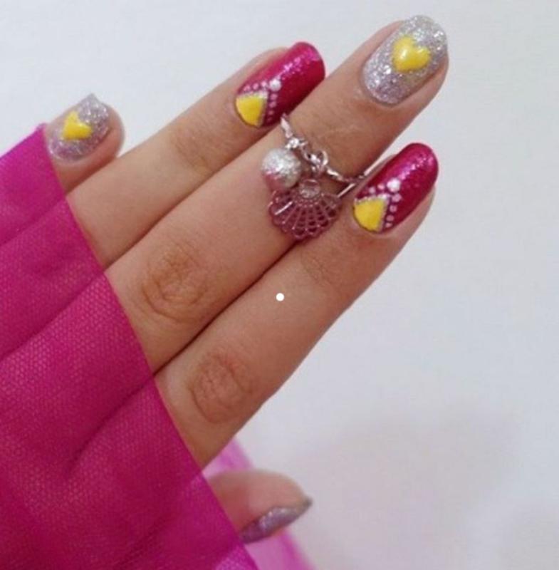 Yellow Hearts nail art by Samia Tehreem
