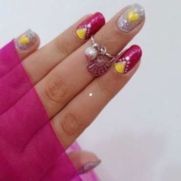 Yellow Hearts nail art by Samia Tehreem