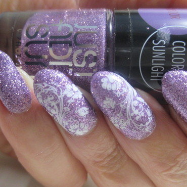 Solar Sparkle nail art by NinaB