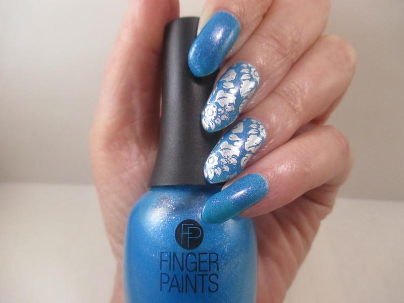 Asymmetrical Chrome nail art by NinaB