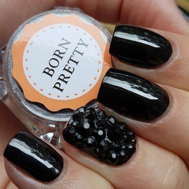 Black chrome powder and rhinestones nail art by Emmelie Slotboom