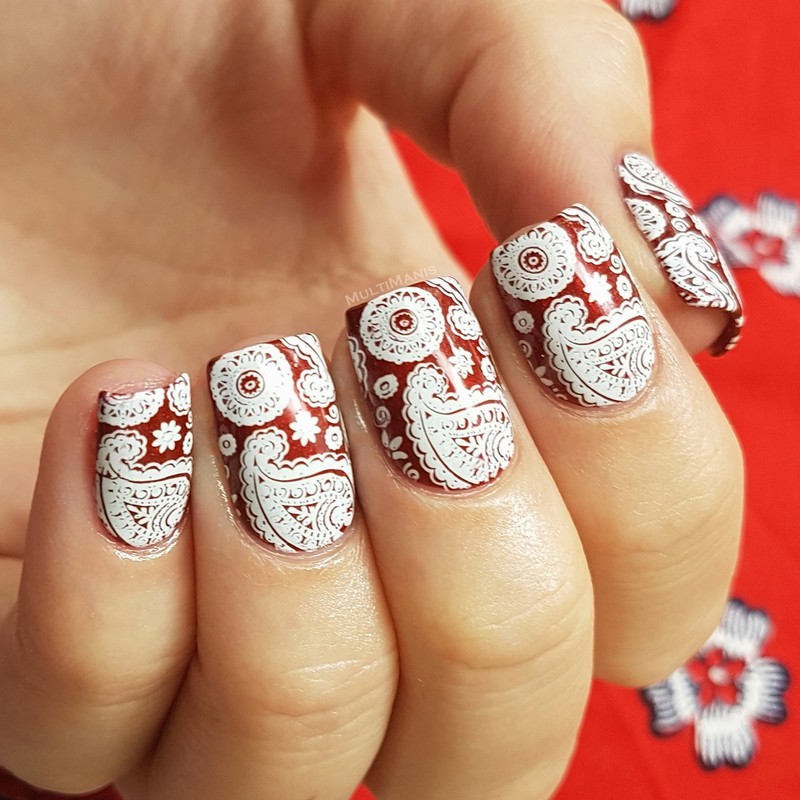Paisleys and flowers on red nail art by Emmelie Slotboom