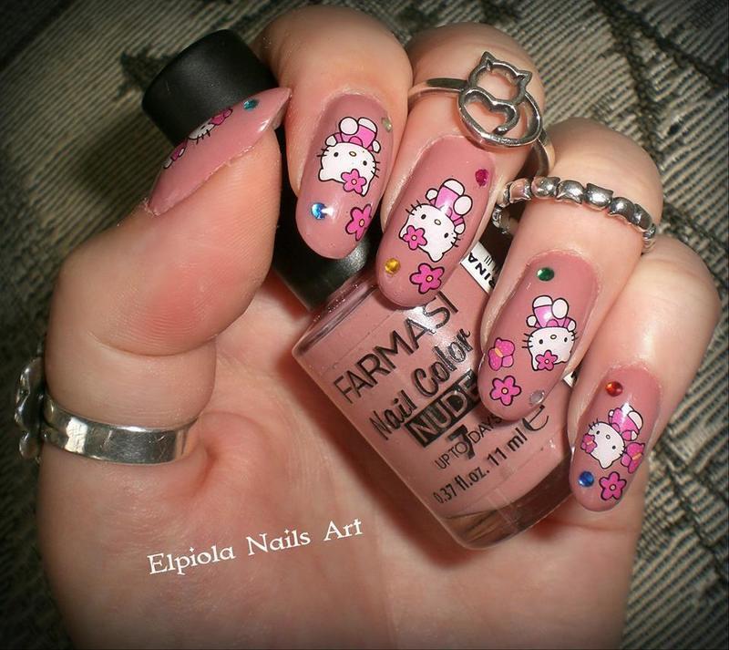 Hello Kitty nail art by Elpiola Lluka