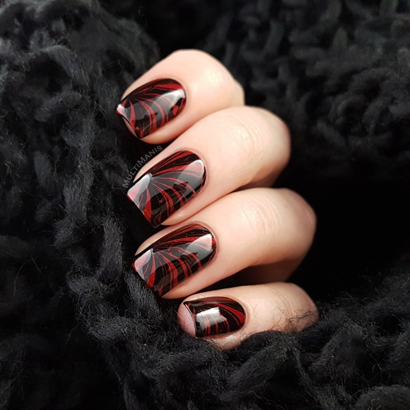 Red and black nail art by Emmelie Slotboom