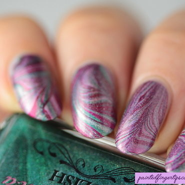 Holo Christmas water marble nail art by Kerry_Fingertips