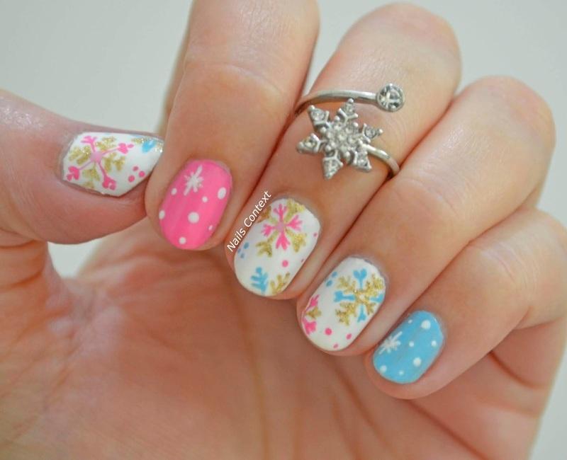 Snowflakes nail art by NailsContext