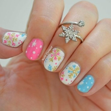 Snowflakes nail art by NailsContext