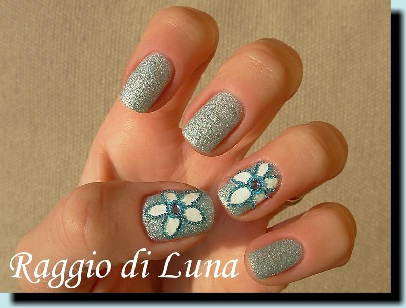 Light blue beads flower nail art by Tanja