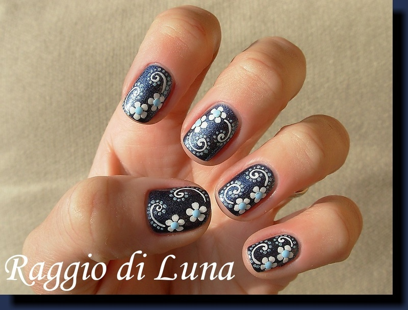 White flowers with holo dots nail art by Tanja