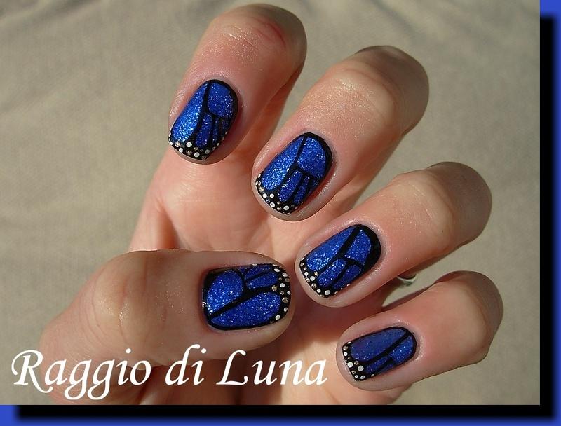 Blue glitter butterfly wings nail art by Tanja