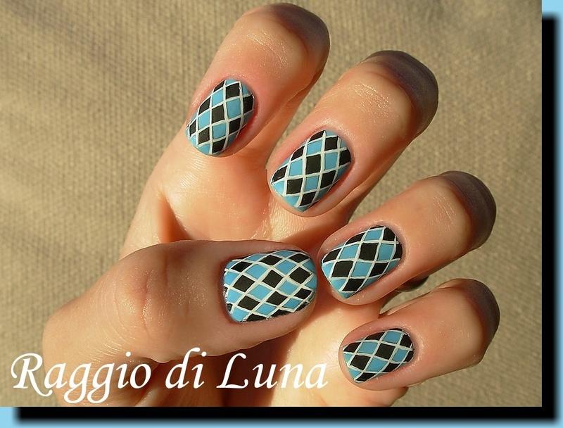 Black & light blue harlequin nail art by Tanja
