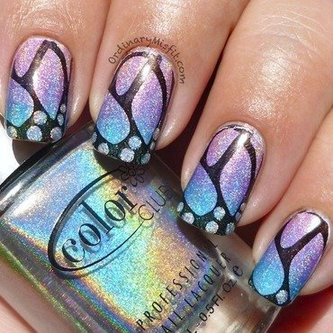 Holo butterfly nail art by Michelle