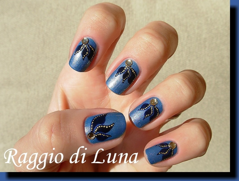 Dark blue flowers with golden dots nail art by Tanja