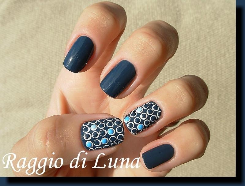 Dots and neon nail art studs on denim blue nail art by Tanja