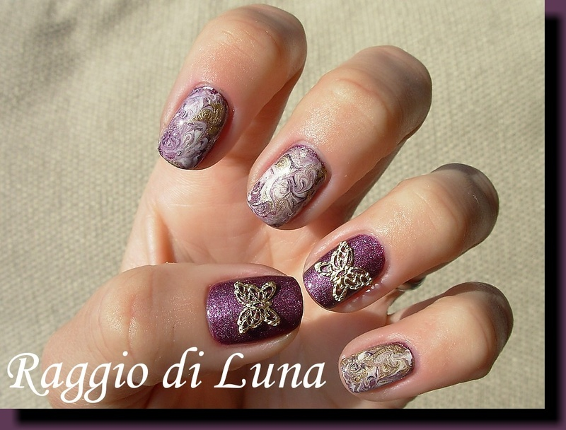 Marble art with golden butterfly nail art by Tanja