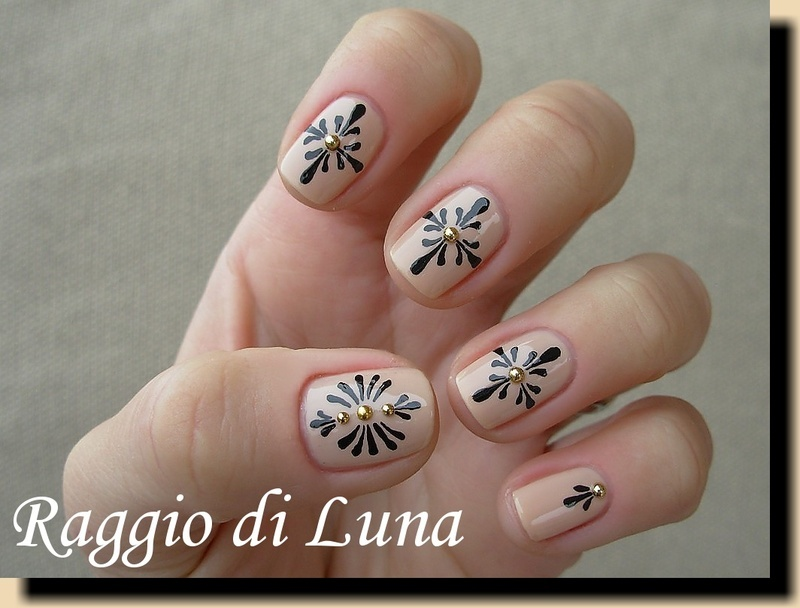 Black abstract flowers on nude nail art by Tanja