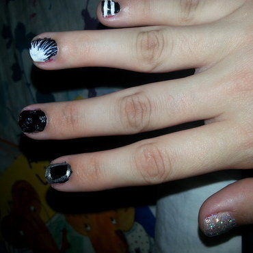 Black, white, and holo nail art by Renataremedios