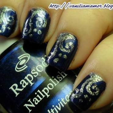 Blue with silver swirls nail art by Isabella