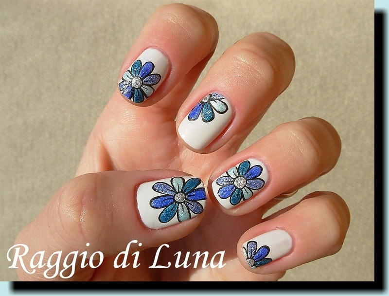 Textured blue flower on white nail art by Tanja