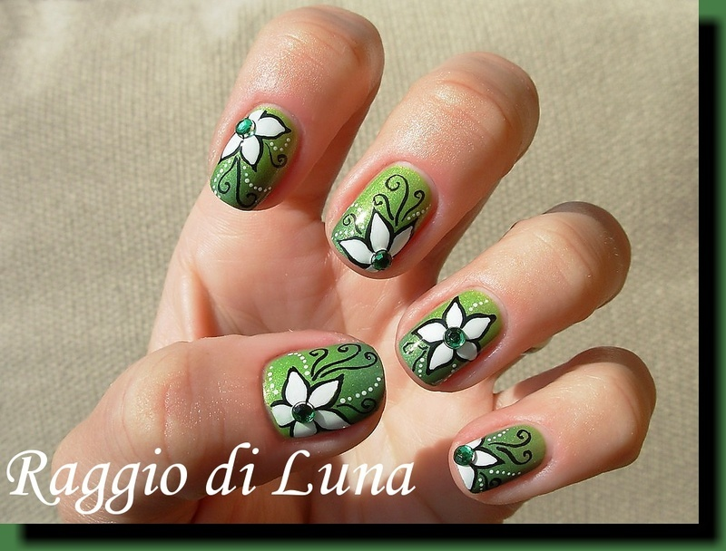 White flowers on green nail art by Tanja