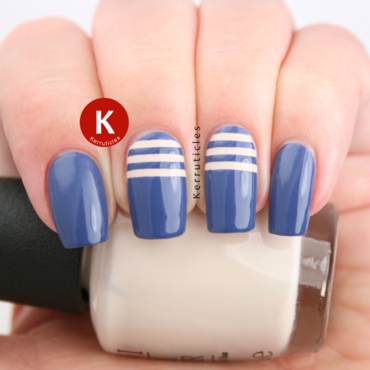 Blue with cream stripes nail art by Claire Kerr