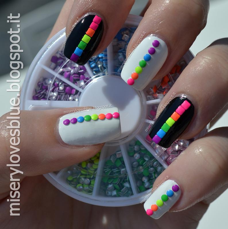 Rainbow Neons nail art by MiseryLovesBlue